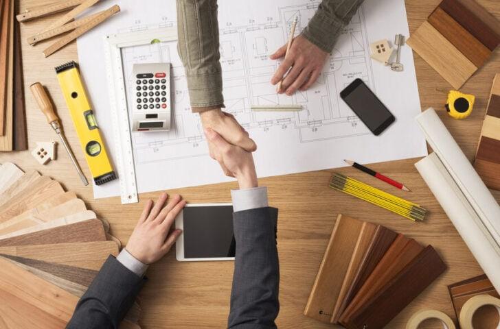 Byggeplaner og håndtryk